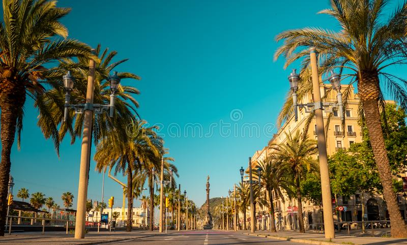 Passeig de Colom street and The Columbus monument or The Colon in Barcelona, Spain. Passeig de Colom street and The Columbus monument or The Colon in Barcelona royalty free stock images