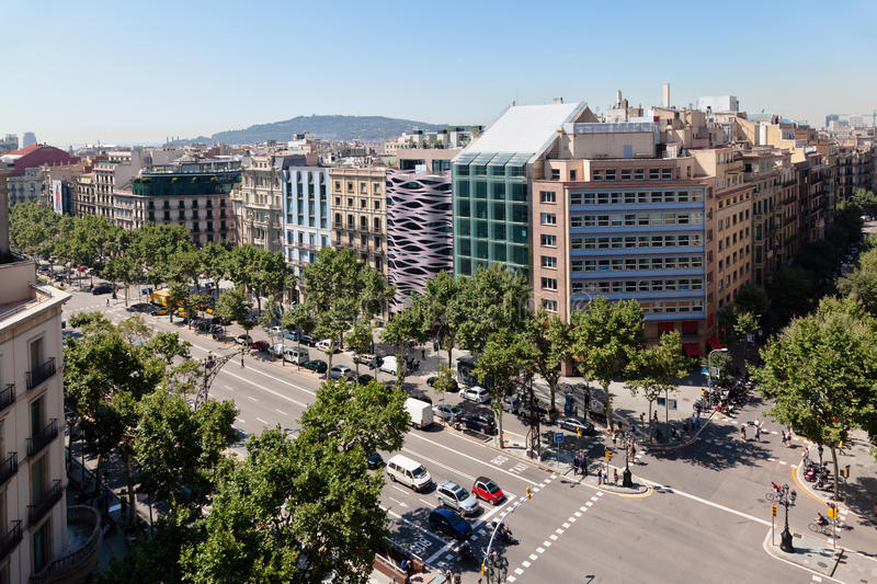 Passeig de Gracia Barcelona Spain. The famous street Passeig de Gracia with its trees and historic buildings, Barcelona, Spain stock photography