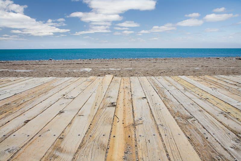 Passeio à beira mar da praia fotos de stock
