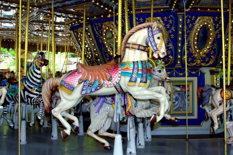 Passeio do cavalo no carrossel fotografia de stock