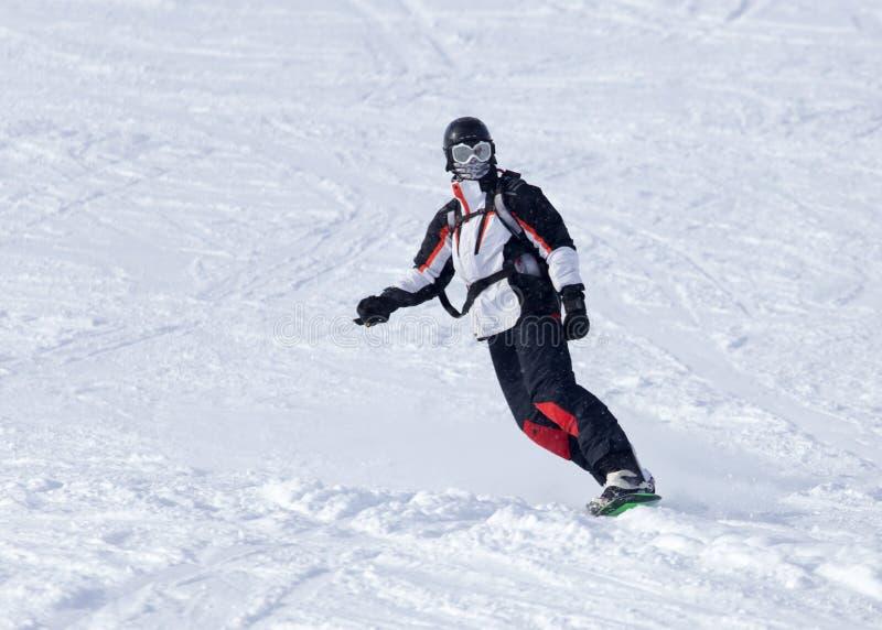 Passeios do Snowboarder foto de stock royalty free