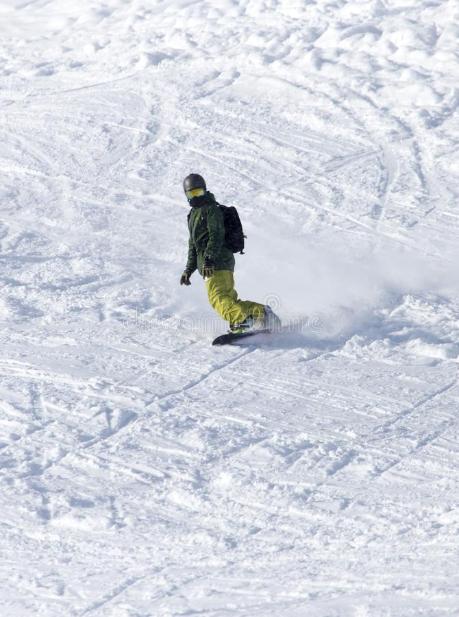 Passeios do Snowboarder fotos de stock