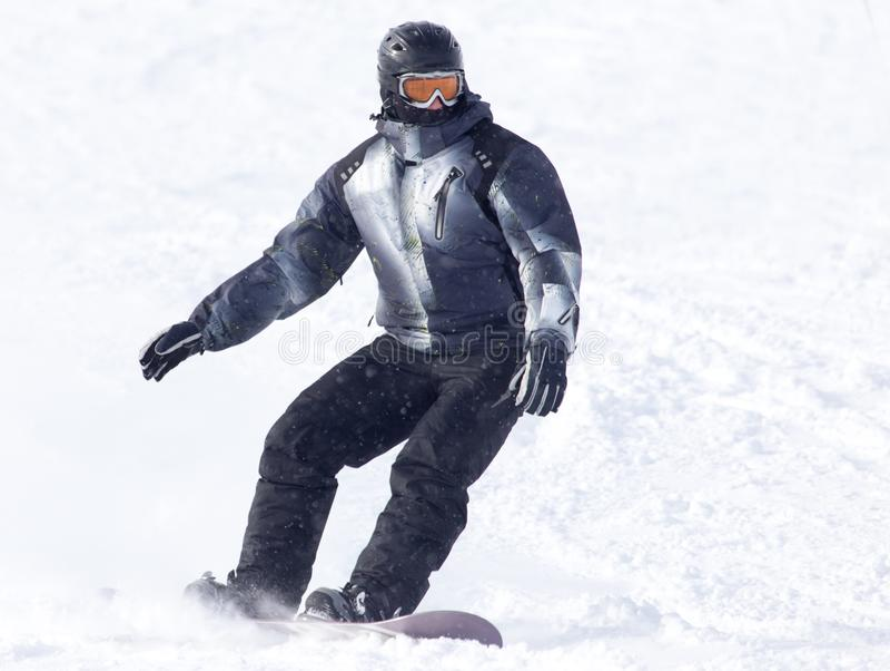 Passeios do Snowboarder fotografia de stock royalty free