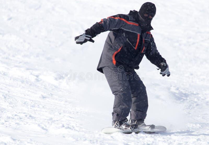 Passeios do Snowboarder imagem de stock