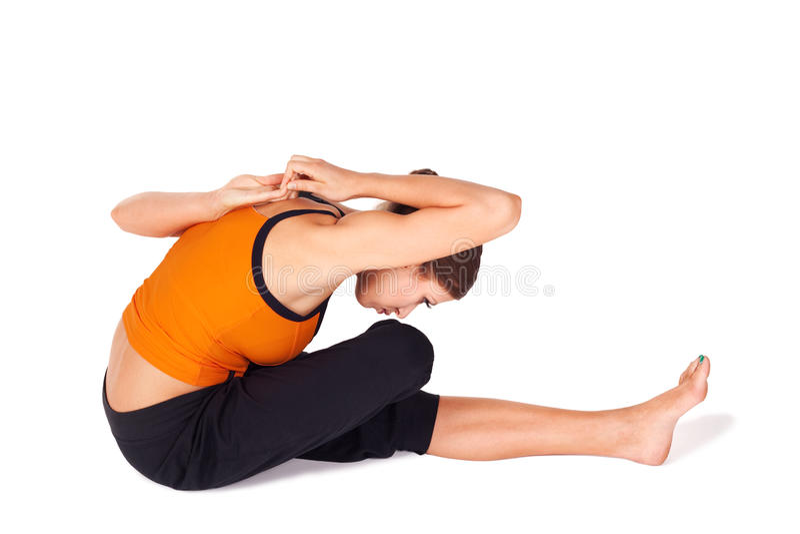 Passende Frauen-übendes Yoga, das Asana ausdehnt stockbild