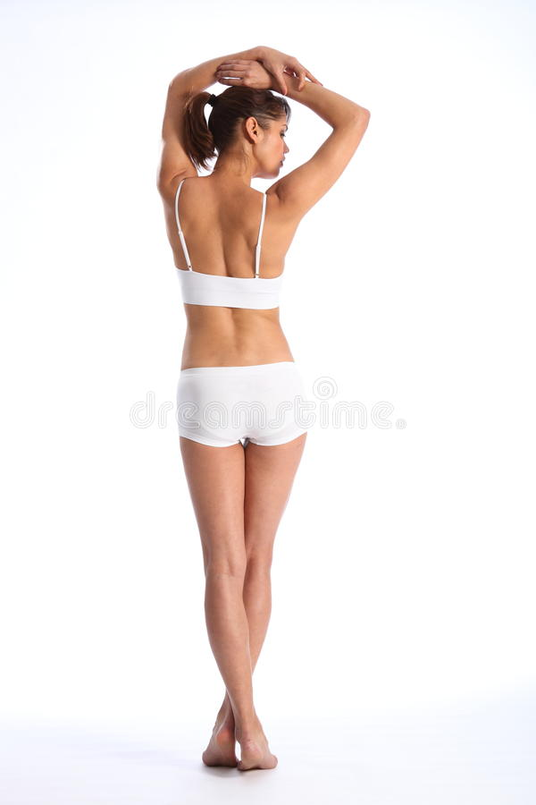 Passende Karosserie der jungen gesunden Frau innen von hinten stockbilder