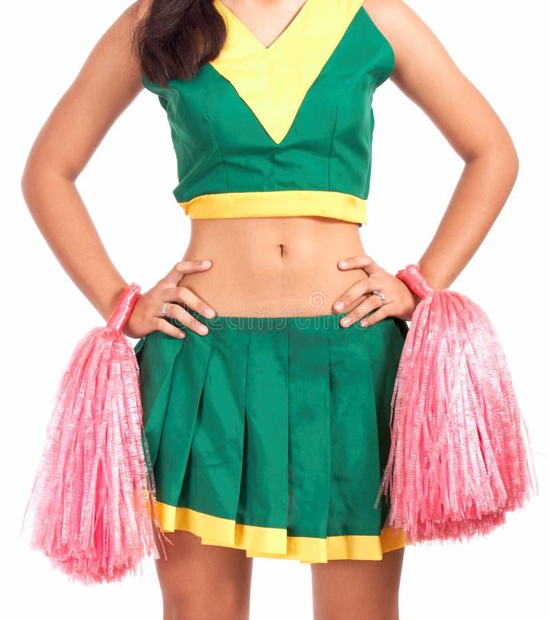 Passende und reizvolle Cheerleader stockfotos