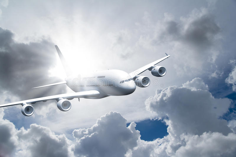Passenger Air Plane Flying. In the sky, front view, cloudy background stock photo