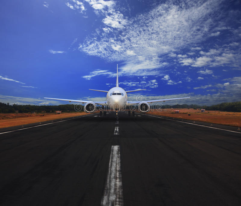 Passenger air plane running on airport runway with beautiful blue sky with white cloud use for transport and traveling journey. Background and backdrop royalty free stock photos