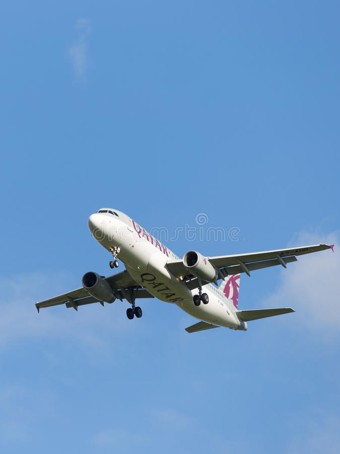 Passenger Airbus A320-232 Qatar Airways. Moscow - August 6, 2015: A passenger Airbus A320-232 Qatar Airways landing at Domodedovo airport and the blue sky on Aug stock images