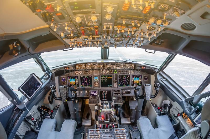 Passenger aircraft interior, engine power control and other aircraft control unit in the cockpit of modern civil passenger airplan stock photography