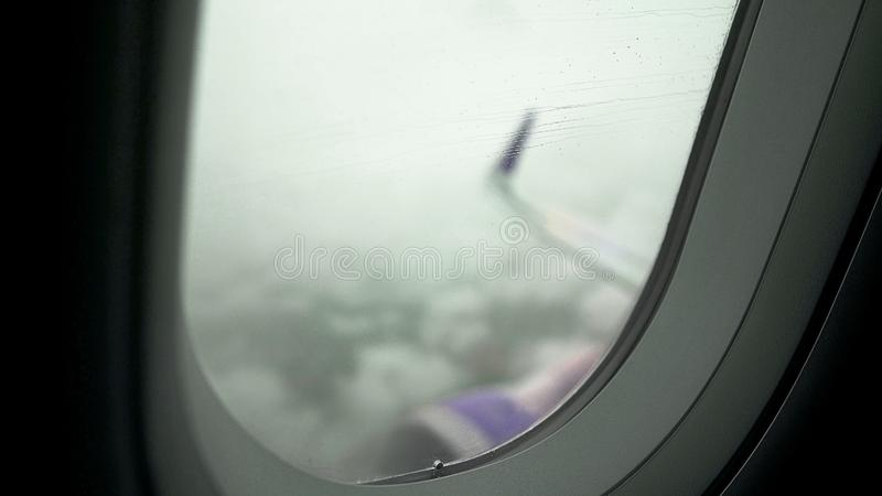 Passenger airliner flying in low visibility rainy sky, high risk of accident. Stock photo royalty free stock images