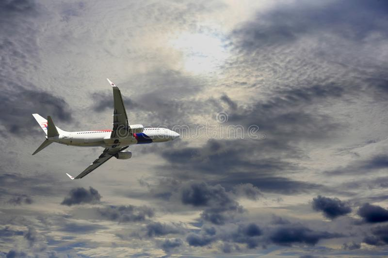 Passenger airplane Boeing 737-4H6 flying travel. Kota Kinabalu, Malaysia - January 03, 2015: Passenger airplane Boeing 737-4H6 flying travel, trip at flight stock photo