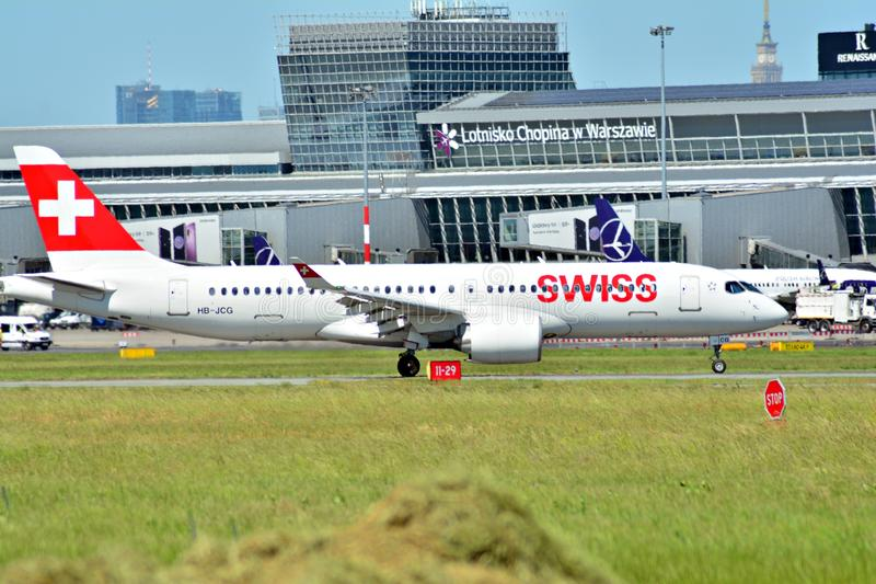 Passenger airplane Bombardier C-Series - MSN 55020 - HB-JCG Airline Swiss International Airlines is flying from the runway of War royalty free stock photography