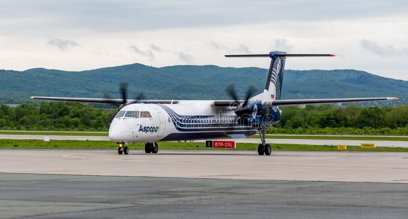 Passenger airplane Bombardier Q400 NextGen of Aurora company just landed. Russia, Vladivostok, 05/26/2017. Passenger airplane Bombardier Q400 NextGen of Aurora royalty free stock photo