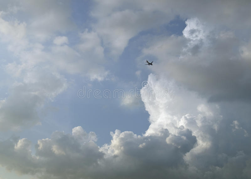 Download Passenger Airplane In Clouds Stock Photo - Image: 26557380