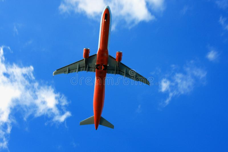 Passenger airplane in the clouds. travel by air transport.  stock photo