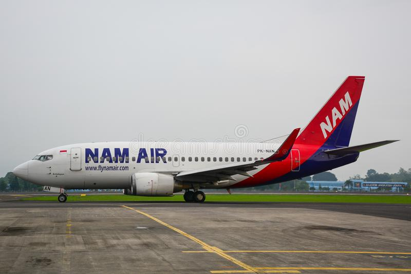 Passenger airplane docking at the airport stock photo