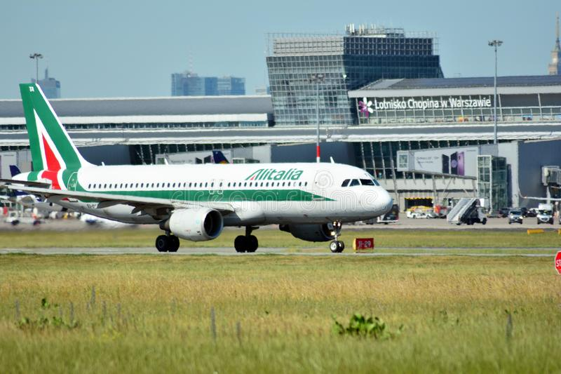 Passenger airplane EI-DTA - Airbus A320-216 - Alitalia is flying from the runway of Warsaw Chopin Airport stock photos