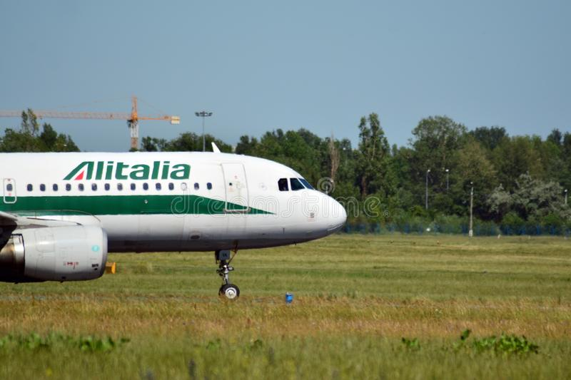 Passenger airplane EI-DTA - Airbus A320-216 - Alitalia is flying from the runway of Warsaw Chopin Airport stock photography
