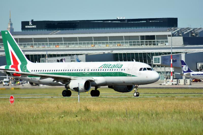 Passenger airplane EI-DTA - Airbus A320-216 - Alitalia is flying from the runway of Warsaw Chopin Airport royalty free stock photography