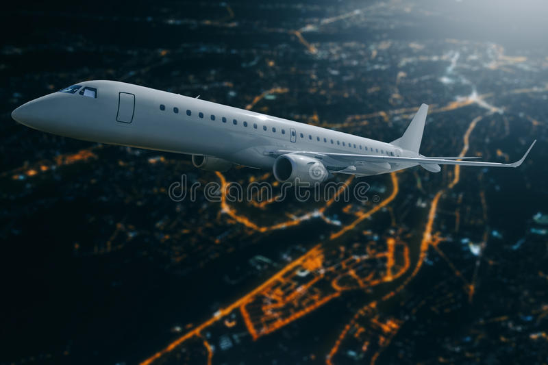 Passenger airplane flying over city at moon night stock photography