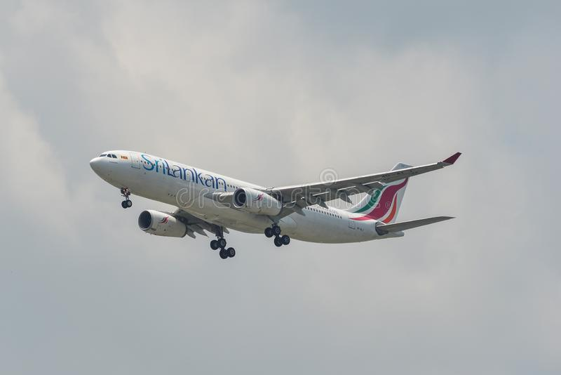 Passenger airplane landing at the airport stock photos