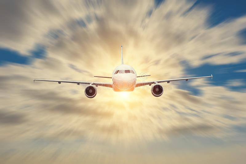 Passenger airplane motion blur, business trip, travel concept. Flying evening sunset.  stock image