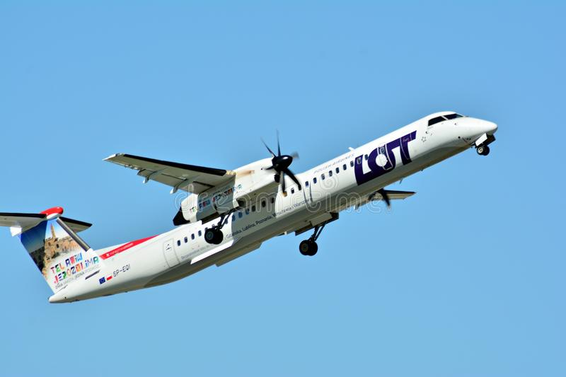 Passenger airplane SP-EQI - Bombardier Dash 8 Q400 - LOT is flying from the runway of Warsaw Chopin Airport royalty free stock image