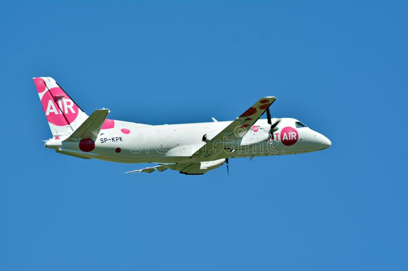 Passenger airplane SP-KPK - Saab 340A - Sprint Air is flying from the runway of Warsaw Chopin Airport. Warsaw, Poland. 28 May 2018. Passenger airplane SP-KPK royalty free stock images