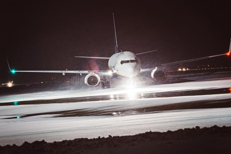 Passenger airplane takes off during heavy snow royalty free stock photo