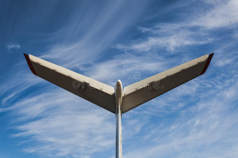 Tail of aircraft. White tail of aircraft on blue sky background. Passenger airplane, view with behind. Tail of an aircraft royalty free stock image
