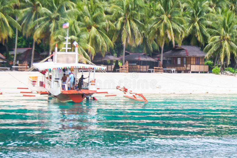 Passenger boat approaching the fist usual destinations of Island Hopping in Samal stock images
