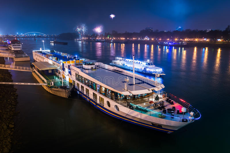 Passenger Boat with Fireworks in Background. Passenger Boat on the Danube River with Fireworks in Background at Night stock photography