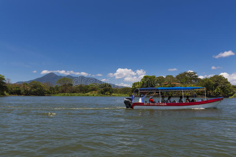 Passenger boat in the Lake Nicaragua, taking passengers between the islets in the Islets of Granada, Nicaragua. Islets of Granada, Nicaragua - April 3, 2014 royalty free stock images