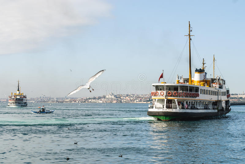 Passenger boat leaving harbour. Passenger boats are ready to dock on Asian side of Istanbul stock photo