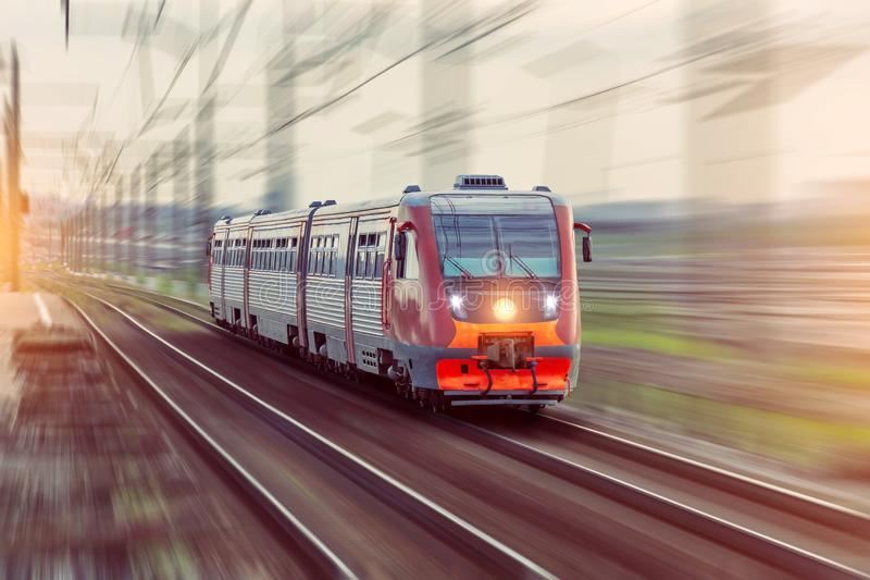 Passenger diesel train travels by rail motion blur effect.  stock image