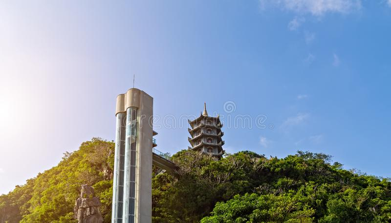 Passenger elevator lift top Marble Mountains. Are actually a series of five marble and limestone formations, which the locals liken to the shape of a dragon at royalty free stock image