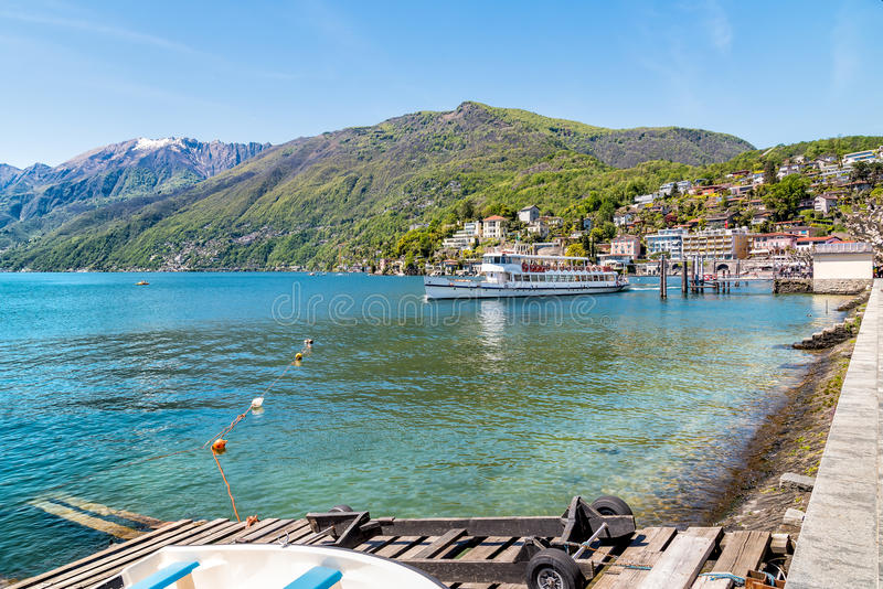 Passenger Ferry at the pier on the shore of lake Maggiore in Ascona. Ticino, Switzerland royalty free stock photos