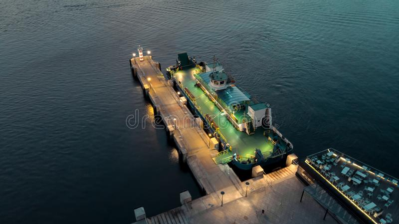 A passenger ferry is waiting for passengers. Evening, lights, europe, lithuania, klaipeda, port, mooring, colors, steal, mental, green, water, coronia stock photography