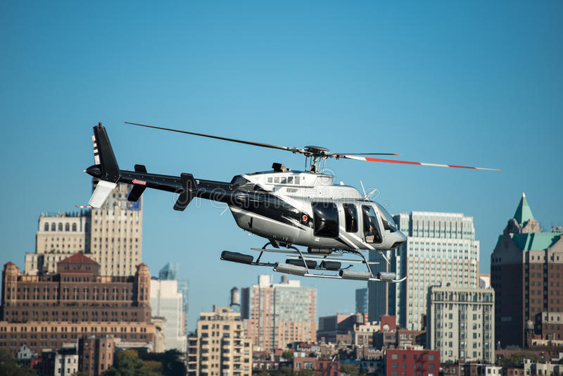 Passenger helicopter flying in New York City royalty free stock photos