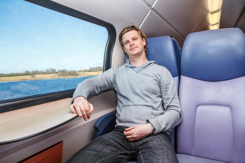 Passenger inside the train. Sitting beside the window royalty free stock images