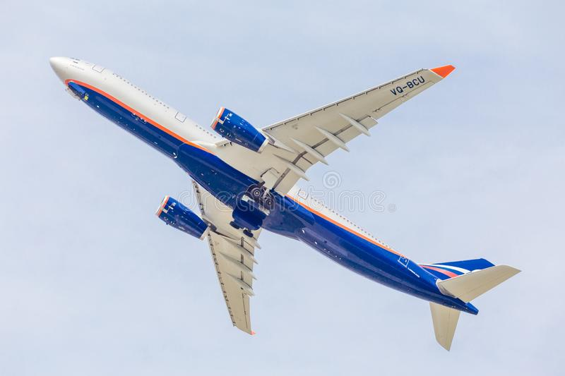 Passenger jet aircraft Airbus A330 of Aeroflot Airlines flies on the blue sky. Journey and holidays concept. Russia, Vladivostok, 10/05/2018. Passenger jet royalty free stock photo
