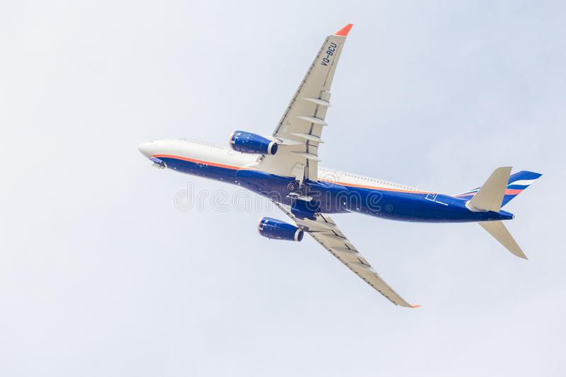 Passenger jet aircraft Airbus A330 of Aeroflot Airlines flies on the blue sky. Journey and holidays concept. Russia, Vladivostok, 10/05/2018. Passenger jet stock photography