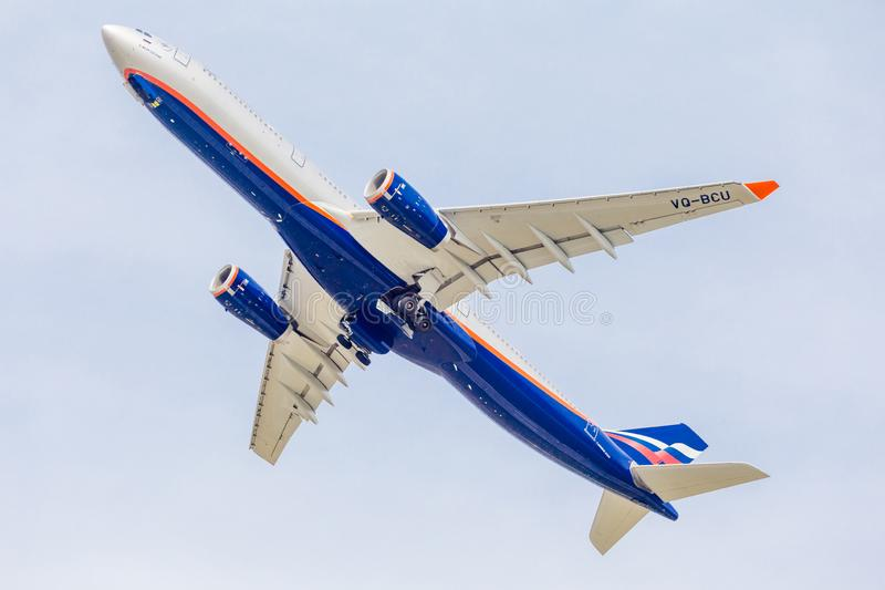 Passenger jet aircraft Airbus A330 of Aeroflot Airlines flies on the blue sky. Journey and holidays concept. Russia, Vladivostok, 10/05/2018. Passenger jet royalty free stock photos
