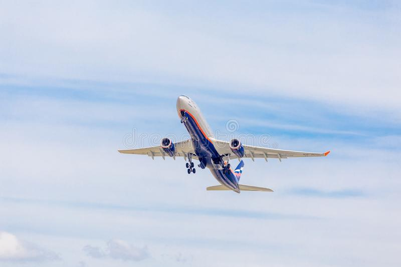 Passenger jet aircraft Airbus A330 of Aeroflot Airlines flies on the blue sky. Journey and holidays concept. Russia, Vladivostok, 10/05/2018. Passenger jet stock image