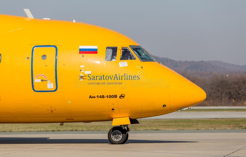 Passenger jet aircraft Antonov An-148-100B of Saratov Airlines company on a runway. Airplane`s fuselage. stock image