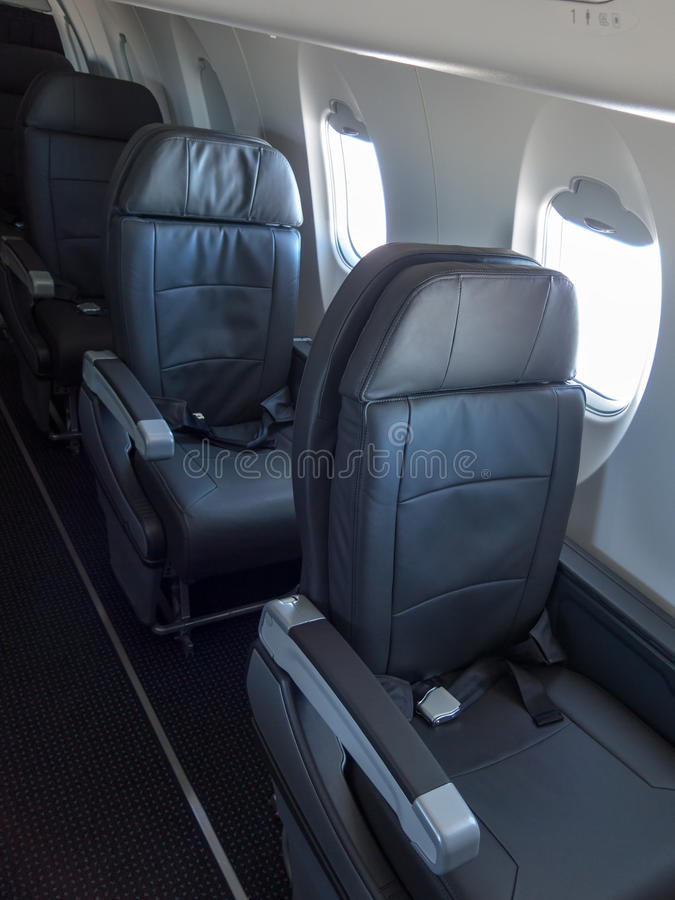Passenger Jet Cabin Airliner Seats. Seats and chairs inside the cabin of a passenger jet airliner or airplane stock image