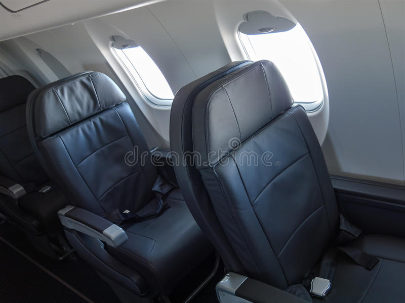 Passenger Jet Cabin Airliner Seats. Seats and chairs inside the cabin of a passenger jet airliner or airplane royalty free stock photo