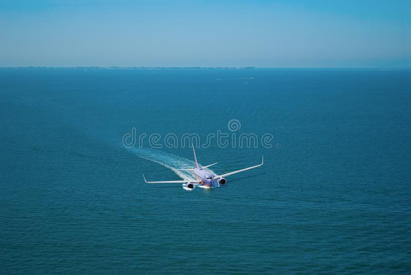Passenger jet plane airliner emergency crash landing on water. A large commercial passenger jet plane airliner making an emergency crash landing on water trying stock photo